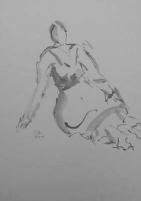 Vrouw zittend op de grond